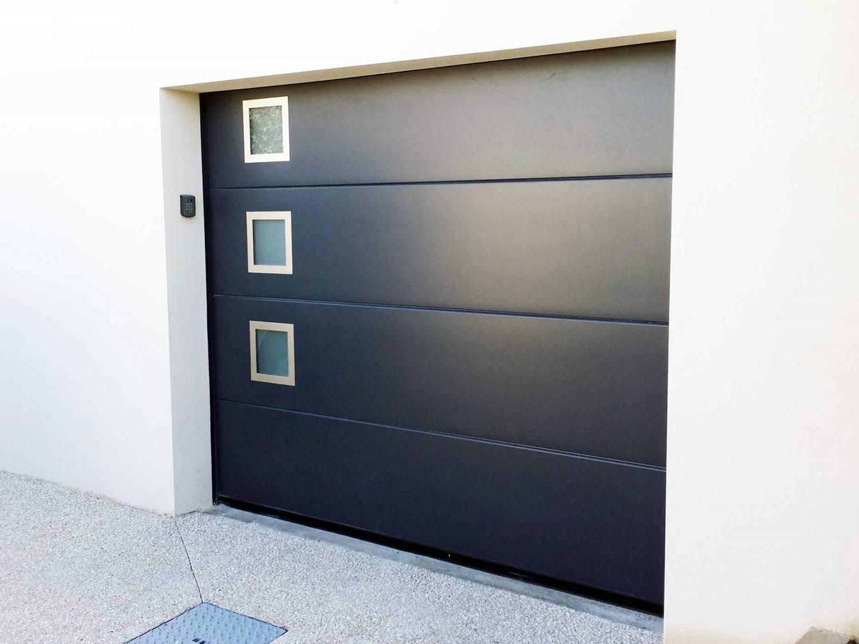 Pourquoi choisir une porte de garage sectionnelle pour for Qu est ce qu une porte de garage sectionnelle